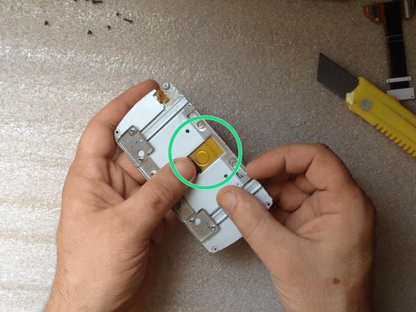 To release the ribbon cable peel off two patches.