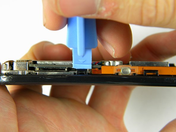 Use the plastic opener tool to unhinge the the locks on the side of the motherboard connecting it to the front casing.