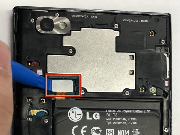 Carefully use the plastic opening tool to pry the ribbon cable connecting the battery to the motherboard of the phone.