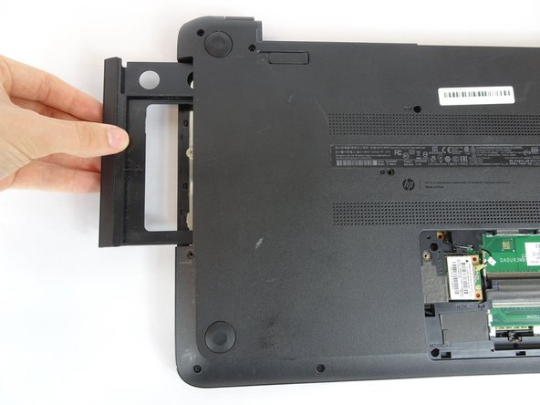 Pull the disk drive out of the laptop.