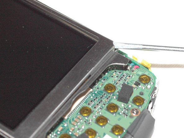 With fine tip screwdriver lift metal frame that holds LCD display on one corner.