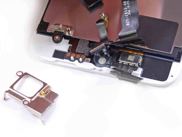 Image 1/2: A few screws hold the 1.2MP FaceTime camera in place.
