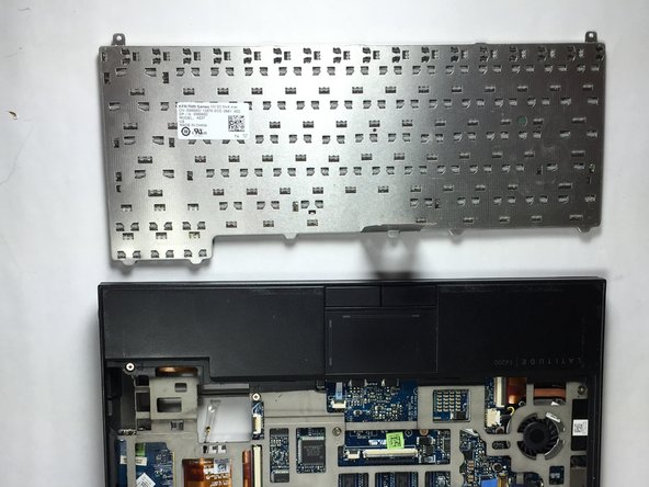Completely lift the keyboard from the device, as they are now disassembled.