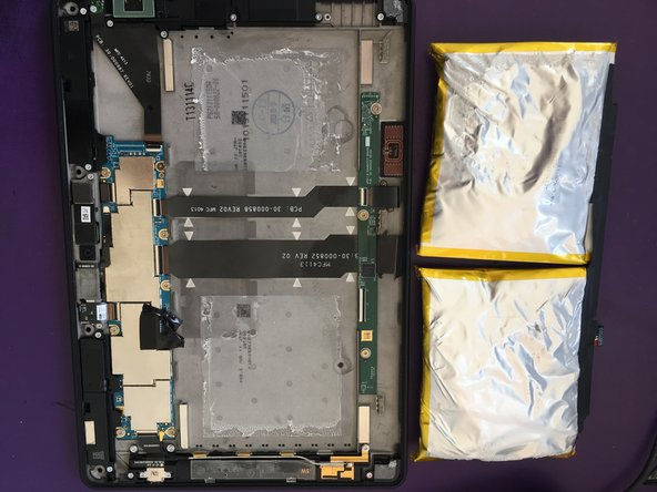 Image 2/2: The second photo here shows the battery after I spent probably 4 minutes slowly prying it away from the glue.