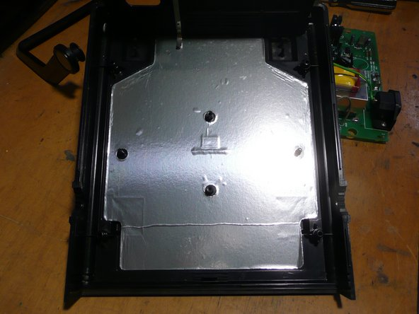 Inside the bottom cover of the function generator, more shielding.