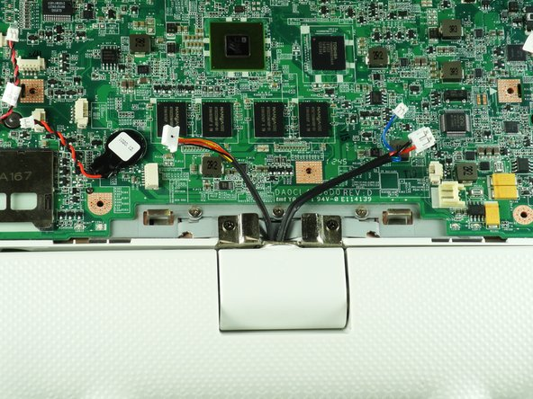 Unplug the two speaker wires from the motherboard.