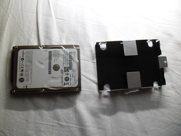 With the screws removed the drive slides out of the bracket.
