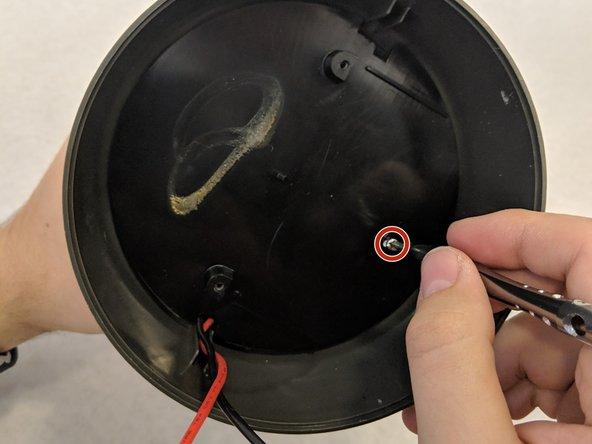 Remove the single 1.2 mm Phillips #1 screw on the bottom of the lantern.