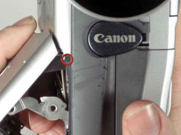 Image 1/1: Remove the #00 Philips 4mm screw shown on the hinge of the tape deck cover.