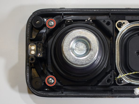 Locate two silver screws (9mm) attached to each speaker shield.