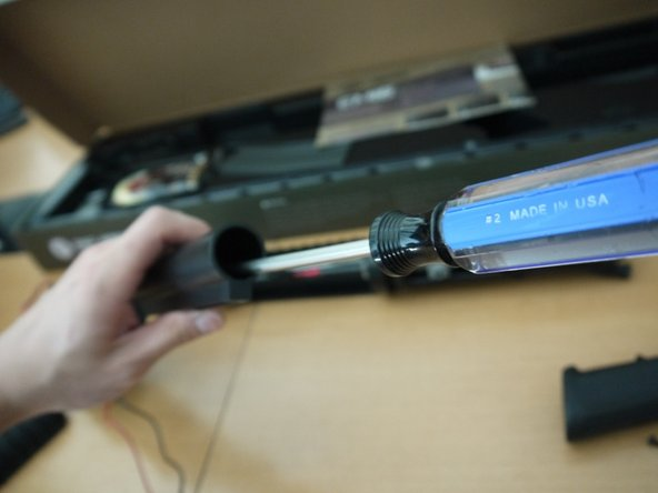 Image 2/3: Remove the buffer tube and the receiver end plate from the lower receiver.