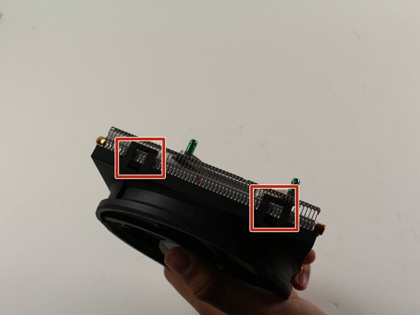 Once the heatsink/fan is off the board, use the plastic opening tool to pry the plastic fan off the metal heatsink at the fan's rectangular clips.