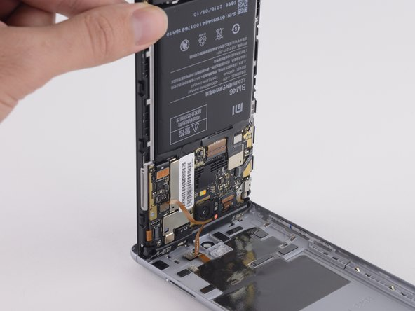 Image 2/2: Fingerprint sensor cable connects the rear case to the interior of the phone, but is long enough that you can safely disconnect it without damaging it.