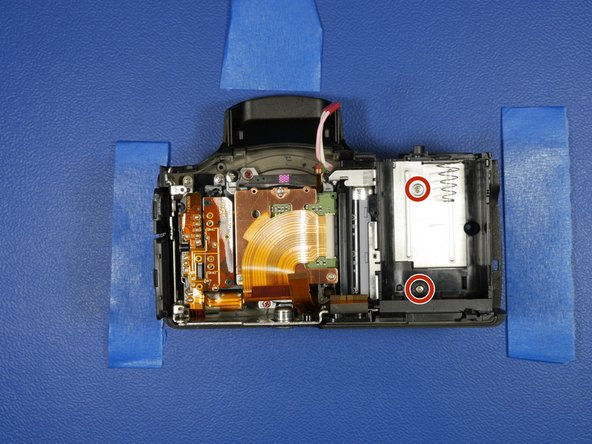 The sensor block assembly, front shell and battery compartment are all that's left of this camera.