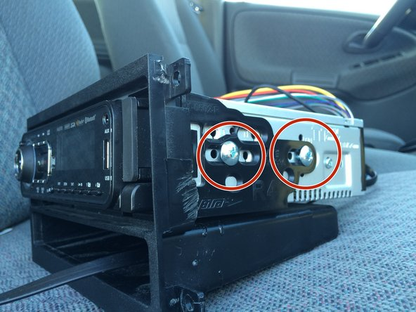 Some car stereos are attached to a mount.