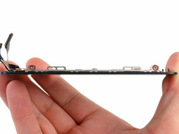 LCDフレームの両側より1.2 mmプラスネジを2本ずつ外します。(計4本)