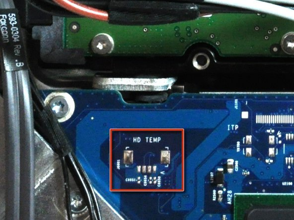 A hard drive thermal sensor may be present on some models. If your logic board is missing the hard drive thermal sensor socket highlighted in red in the first picture, skip this step.