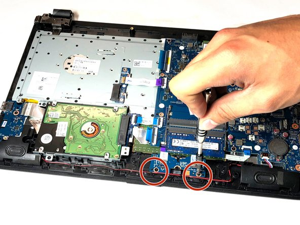 Remove the two  3.3mm Phillips-head screws that secure the trackpad circuit board to the top cover.