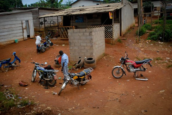 Motorcycle roadside repair in Cameroon