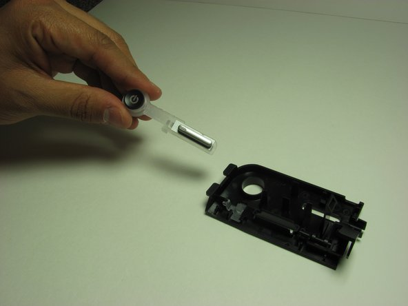 Remove the plastic holder from the face plate after the slots are loosened.