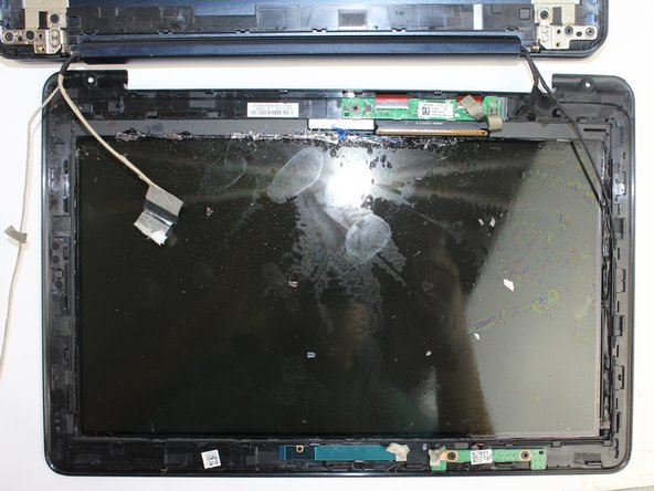 After all connections have been removed, use the metal spudger and pry the screen itself from the screen casing.