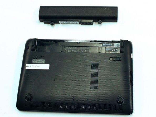Continue to push the battery upwards until it is completely separated from the laptop as shown.
