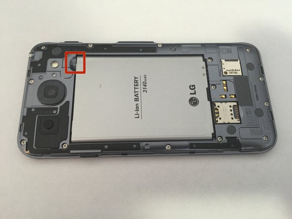 Image 1/1: To remove the battery, pull up from the red mark using your finger. The battery should come up at an angle, and easily be able to be removed.