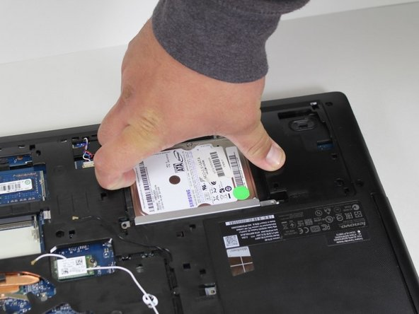 Shift the hard drive to the right and you will feel it click. That means it has been unlocked and can be removed.