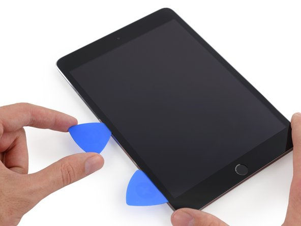 Take the first pick you inserted and slide it up toward the top corner of the iPad.