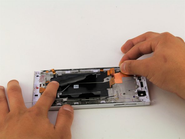 Use your hands to grab the side panel of the device.
