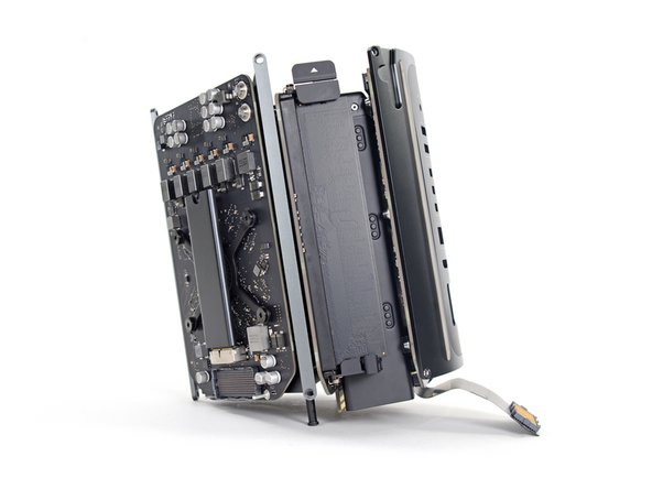 Image 1/1: We recommend laying the Mac Pro on the corner of the heat sink and the two standoff screw posts that attach to the interconnect board.