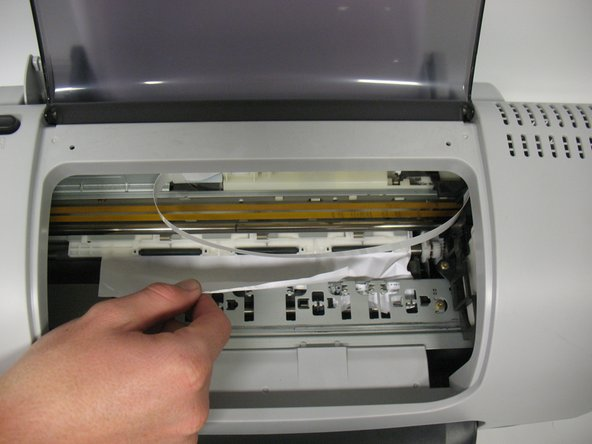 If the print cartridge is in the way, gently push it to the side.