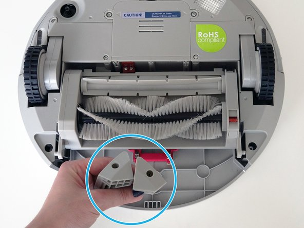 Then, remove the corner pieces that were held down by the screws.