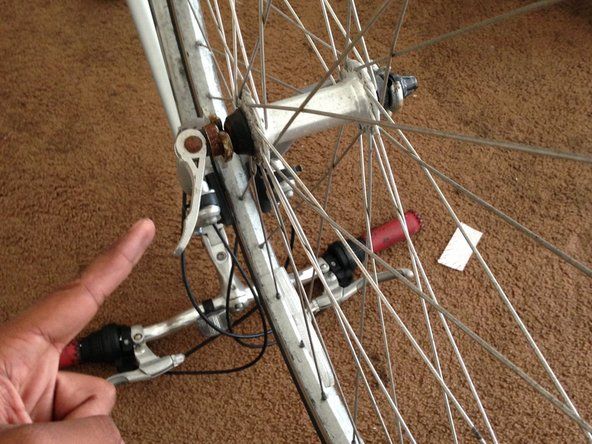 First, remove the front wheel from the frame by unscrewing the adjustable screw