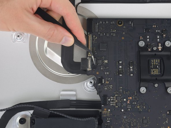 Image 1/3: Pull the FaceTime camera cable straight out of its socket on the logic board.