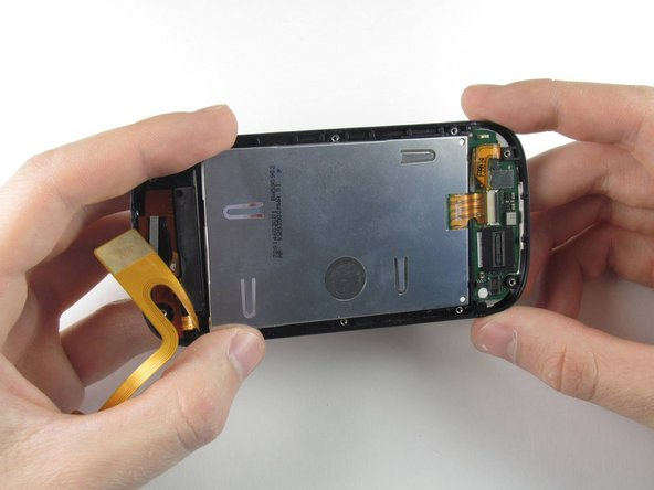 With the digitizer held between two fingers, gently pull it away from the bottom of the phone until the digitizer flex cable has been completely removed from its socket.