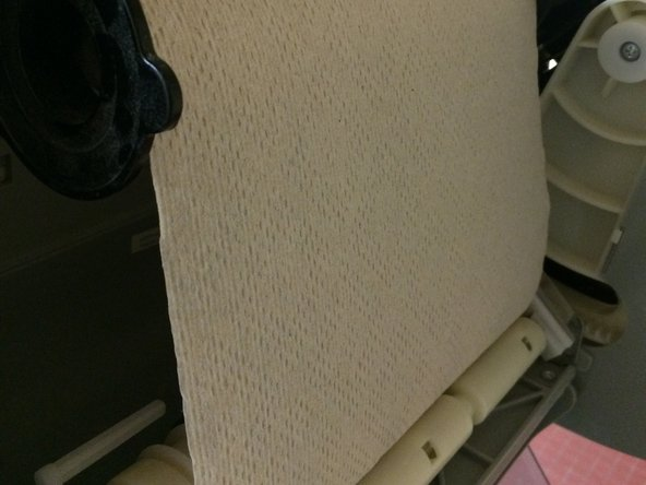 Tear off the paper towels just above the rollers.