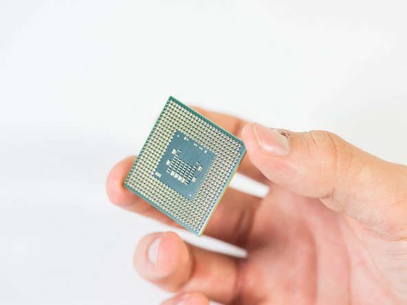 Make sure you pull straight up on the CPU when removing it.  Also be careful not to touch the pins on the CPU as they are thin and will bend very easily.