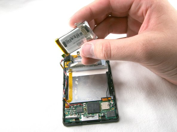 Remove the battery from the device with the cables still connected.