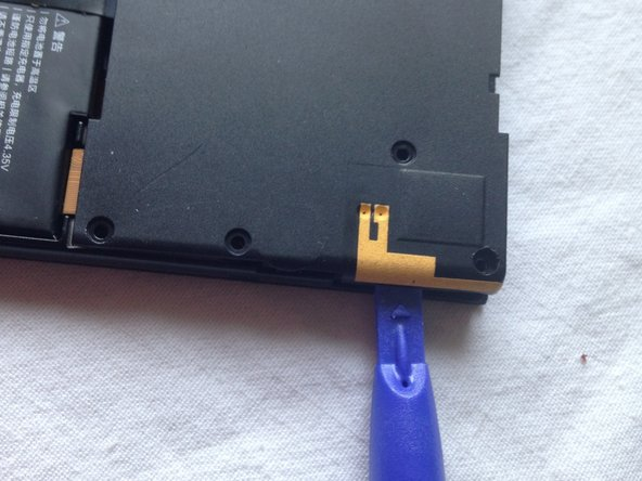 Beware! The NFC is glued to the cover. So do not pull the cover forcefully. It will come easily at the next step.