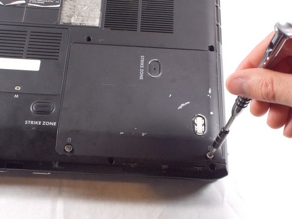 Remove the two 4.5mm Phillips #1 Screws that hold the HDD cover in place.