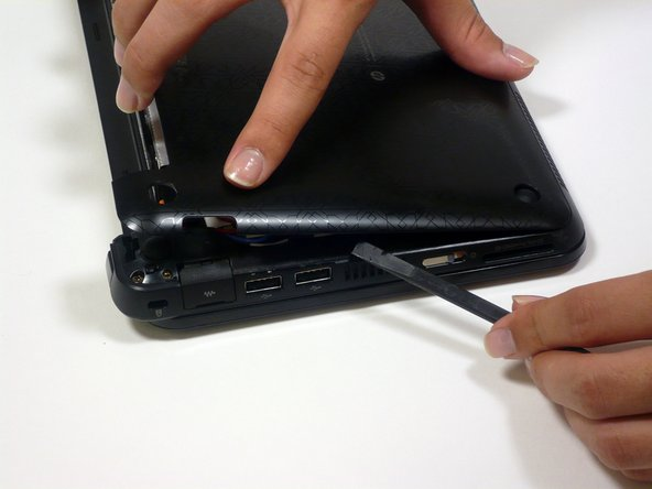 If the back case does not seperate from the netbook easily, use the spudger to pry off the back case by the edge near the battery compartment, and work your way to the sides. The case will then pivot from the front edge.