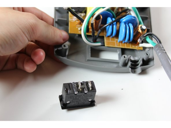 Carefully remove the unsoldered power switch component.
