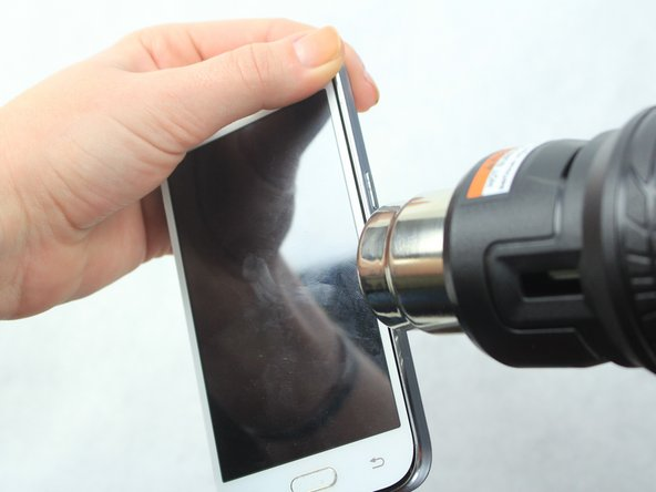 Heat the frame with a heat gun or hair dryer until the adhesive is loose.