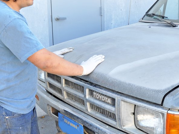 Make sure the hood prop rod is secured in its holder to prevent damage.