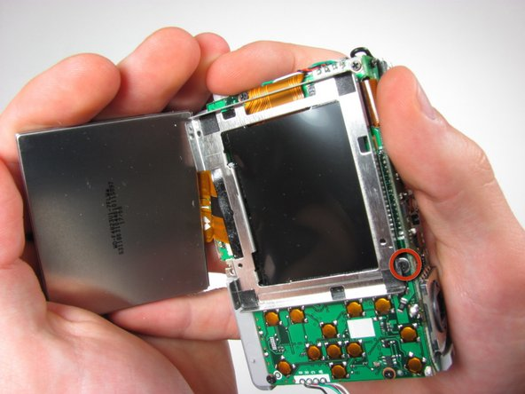 Remove 3mm screw from LCD casing using #00 screwdriver.