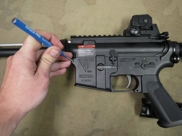 In order to remove upper receiver, you must first push out the body pins. (The body pins do not come all the way out.)