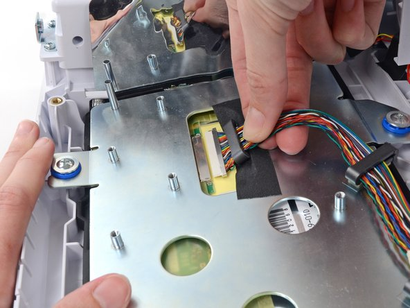 Pull the LCD cable connector, firmly and evenly, straight out of its socket.