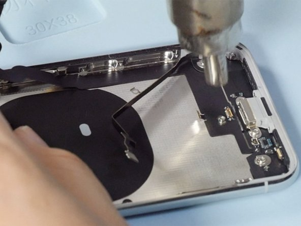 Heating the charging port flex  cable then we can remove it easily