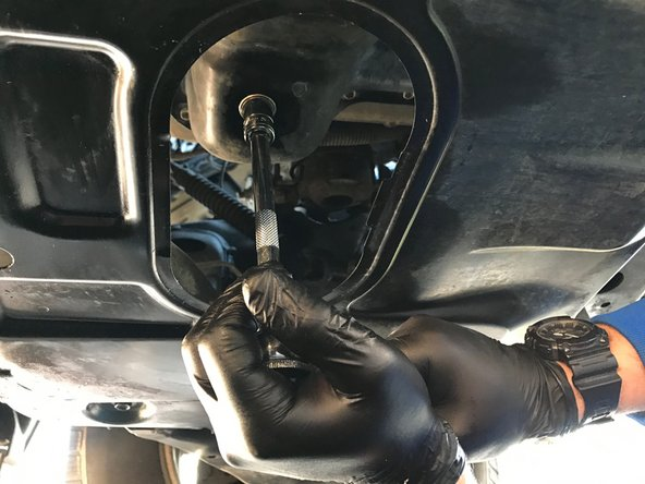 Image 2/2: Only tighten the drain plug until it is snug. Over-tightening the oil drain plug can strip the threads or crack the oil pan.